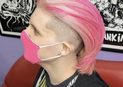 Person with two toned hair, blonde and pink.