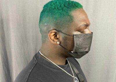 Person with green hair.