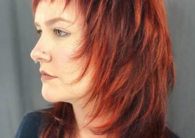 Person with two toned hair, black and red.
