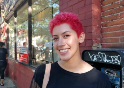 Person with pink hair.