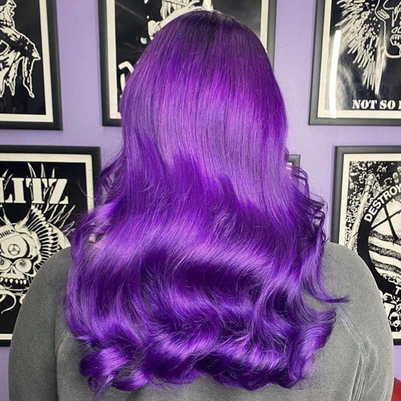 Back shot of a woman with bright purple dyed hair